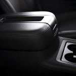 Armrest and Cups Holder - Modern Vehicle Interior. SUV Armrest. Transportation Photo Collection.