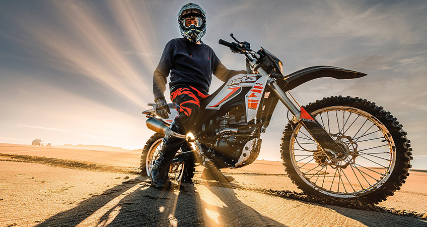 motorcycle desert sunset